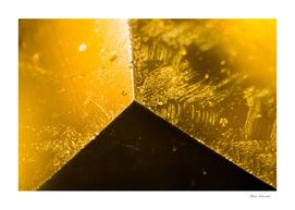 Yellow gem under the microscope
