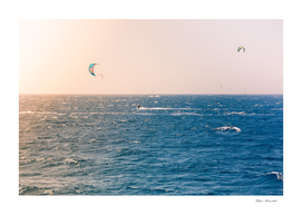Windsurfers sailing in the Red Sea
