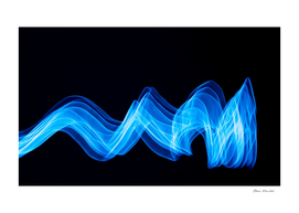 Glowing abstract curved blue lines