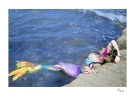 Rainbow Mermaid in the water