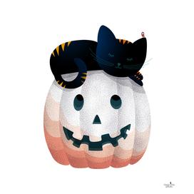 Tired kitty on the Halloween pumpkin