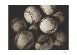 Grungy Baseballs on a Shelf