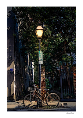 Bike on Lamp Pole at Night-Edit