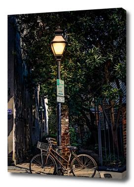 Bike on Lamp Pole at Night-Edit