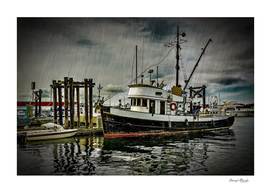 Old Fishing Trawler at Dock in Rain