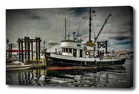 Old Fishing Trawler at Dock in Rain
