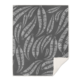 Abstract white bird feathers on a gray background or palm