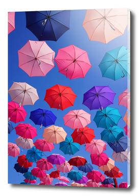 Colorful umbrellas with blue sky