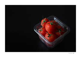 Red tomatoes in plastic box