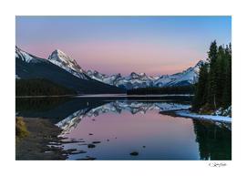 Pink colors in Maligne Lake, Jasper, Canada.
