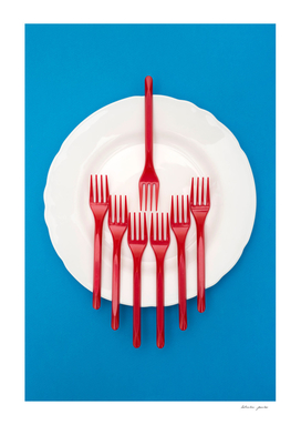Still Life with plastic forks and a plate