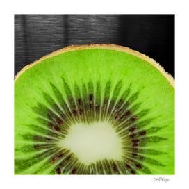 Bright Kiwi Fruit On Metallic