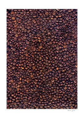 Background of grains of roasted coffee close-up