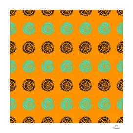 Linocut mandala pattern on saffron background