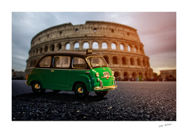 green car and Colosseum