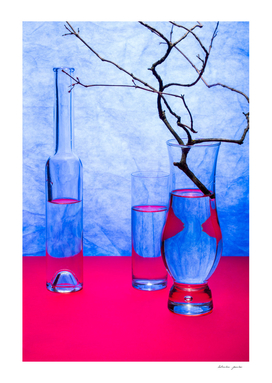 Still life with glass objects on a blue background