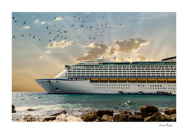 Front of Luxury Cruise Ship Moored Beyond Rocks with