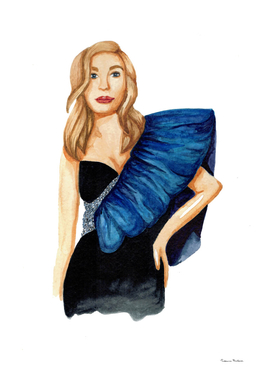 Fashionable girl in evening dress with blue flounce.