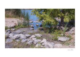Beautiful rustic stones near lake shore water