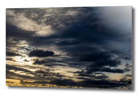 Dramatic dark clouds in the sky at sunset