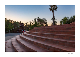 Beautiful red stone steps to a church with Palm tree