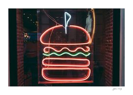 Burger neon icon. Illuminated hamburger fast food symbol