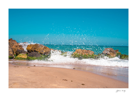Rocks and crushing waves. Sand and Turquoise sea water.