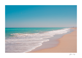 Tropical beach. Sand and  turquoise sea water.