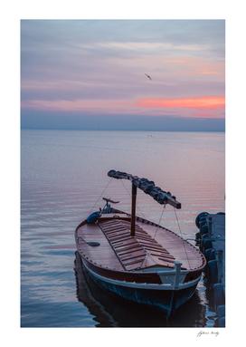 Sunset on the lake. Docked gondola boat.Fishing boat. Spain