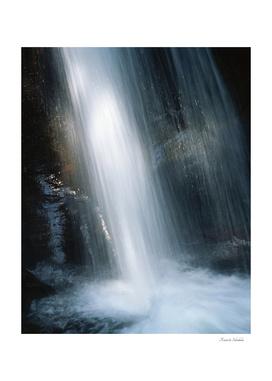 Waterfall illuminated by a ray of sunlight