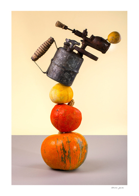 Abstract still life with pumpkins and blowtorch