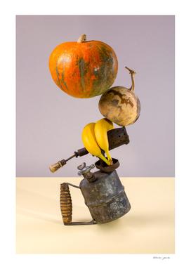 Abstract still life with pumpkins, blowtorch and bananas.