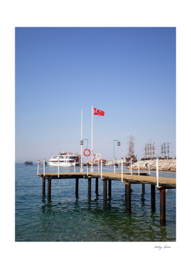 Pier with a view of the yacht (155 beach, Kemer, Turkey)