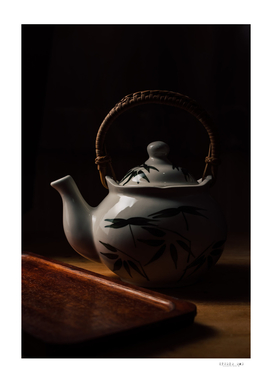 Porcelain teapot on wooden table