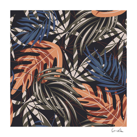 trend seamless pattern with-colorful tropical leaves
