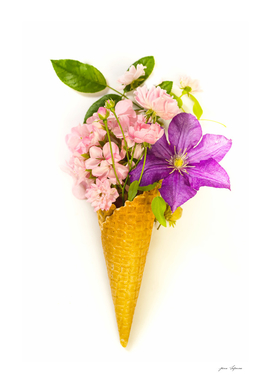 Waffle cone with   clematis, pelargonium and roses