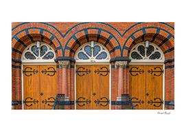 Three Doors in Red Brick