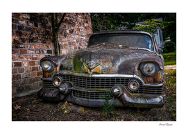 Old Caddy by Brick Wall