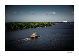 Dark Tugboat on River