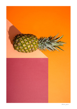 Geometric still life with pineapple on a colored background