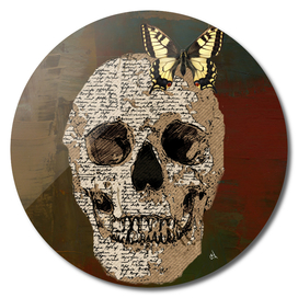 Newspaper Skull and Yellow Butterfly Against Bronze Slate