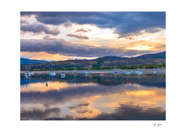 Lake and Boats at Sunset in the Rocky Mountains