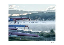 Calming Sunrise on Foggy Lake Waters with the Canoes