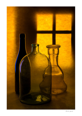 Still life with glass objects on a window background