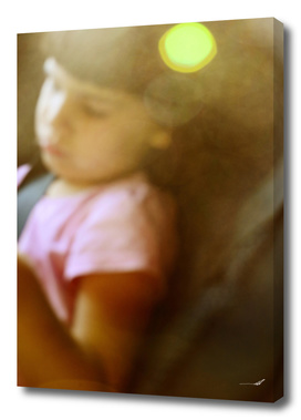 Young girl in car