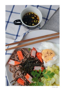 Buckwheat noodle served with dipping sauce