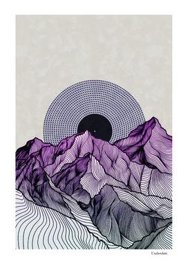 Surreal sunrise behind purple mountains