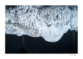 White Waters and Black Sand Coastal Landscape Photograph