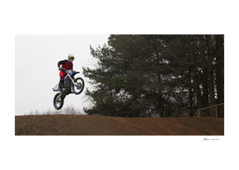 Jump of a motorcyclist during a Motocross Race