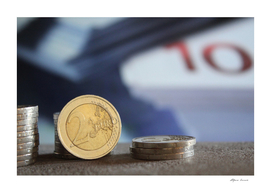 Euro coins and banknotes - wealth